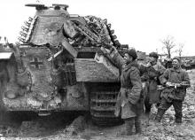 """Soviet soldiers inspect a """"Panther"""" tank captured in Uman, March 13, 1944."""